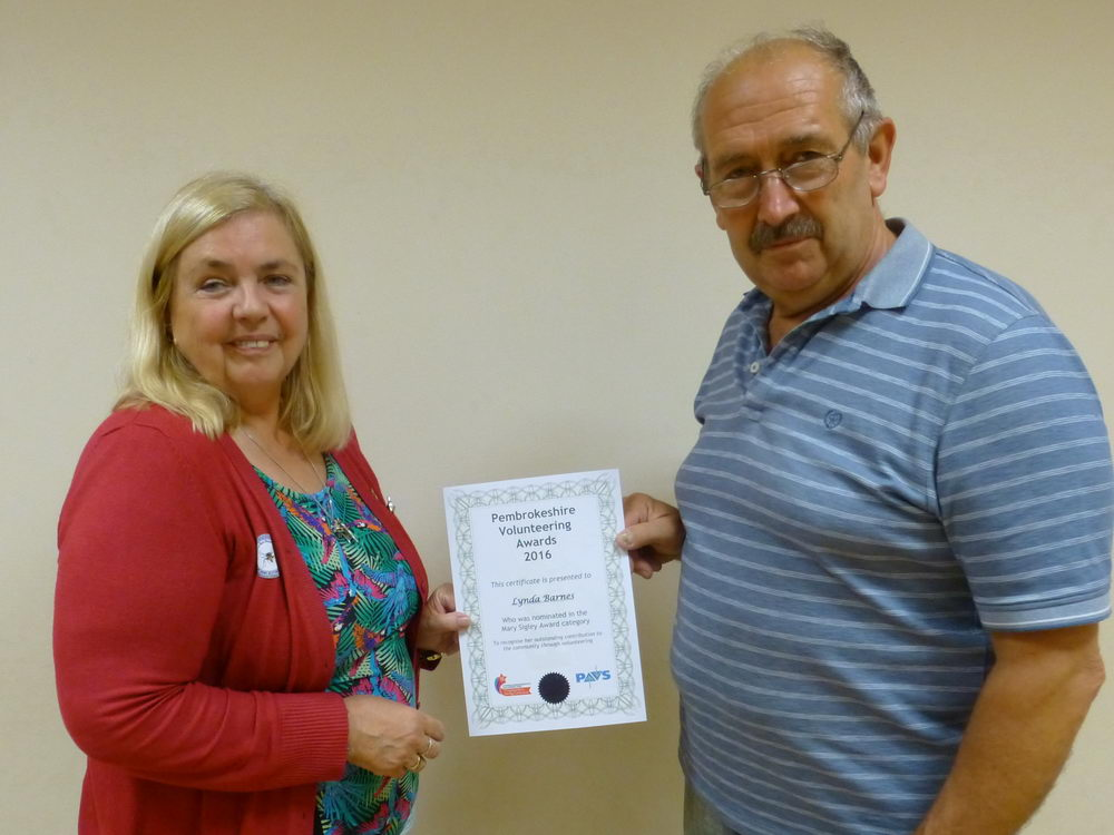 Lynda Barnes (volunteer) with Roger Howells (Current Chairman)