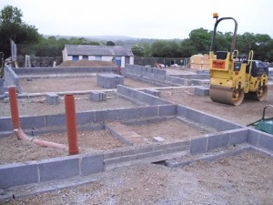 Footings and base walls in place